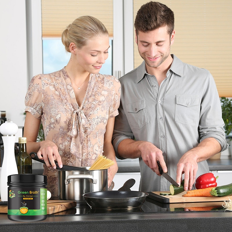 green broth by design and young couple cooking